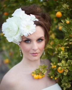 Прическа с цветами для невесты без фаты